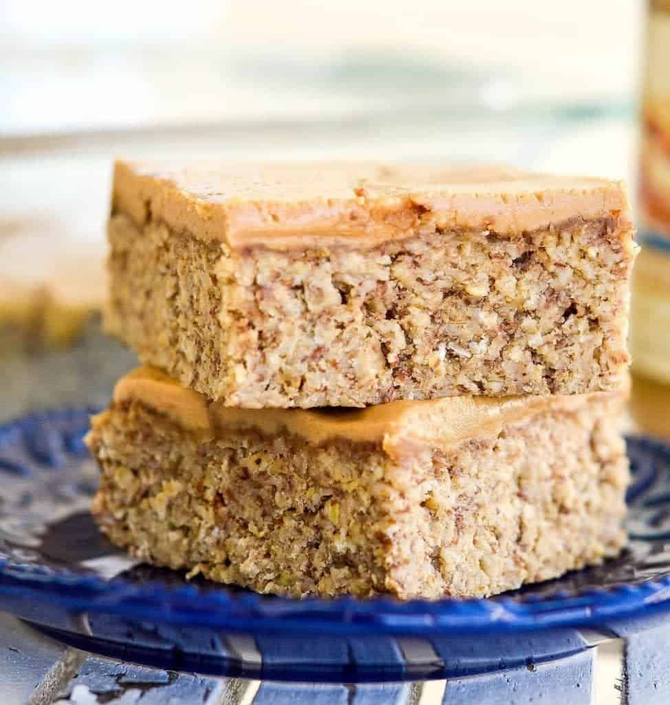 Front view of two Peanut Butter Oatmeal Breakfast Bars stacked on top of each other on a plate