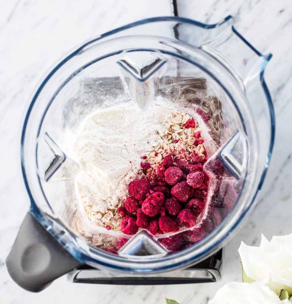 Overhead view of the dry ingredients in a Vitamix blender, the first step in making raspberry baked donuts