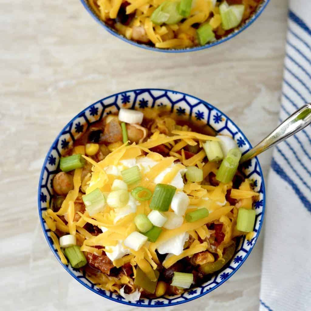 The BEST Healthy Crockpot Chicken Chili! Made in the crockpot and loaded with veggies! Perfect meal to feed a crowd, plus it's freezer-friendly! Gluten & Dairy-Free!