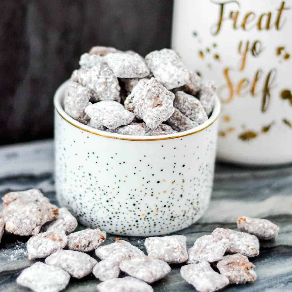 The Best Puppy Chow Recipe EVER! Only 4 ingredients and a few minutes will result in an irresistible chocolate and peanut butter dessert! Gluten-free, dairy-free, and vegan!