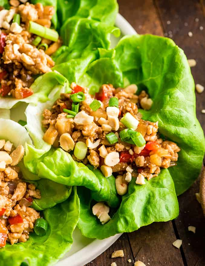 up close overhead view of an Asian chicken lettuce wrap on a plate