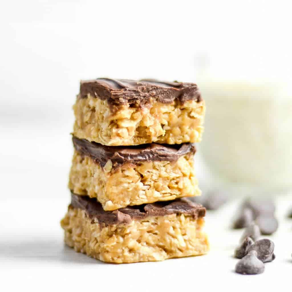Front view of a stack of three No-Bake Chocolate Peanut Butter Coconut Bars
