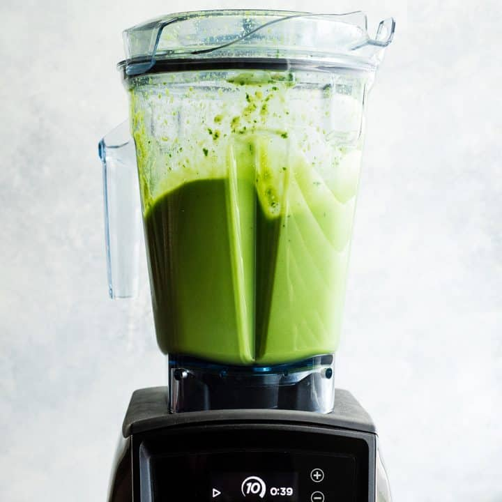 front view of a chocolate peanut butter green smoothie blending in a Vitamix blender