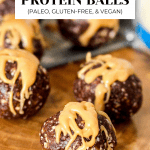 Almond Butter Protein Balls with drizzle on them.