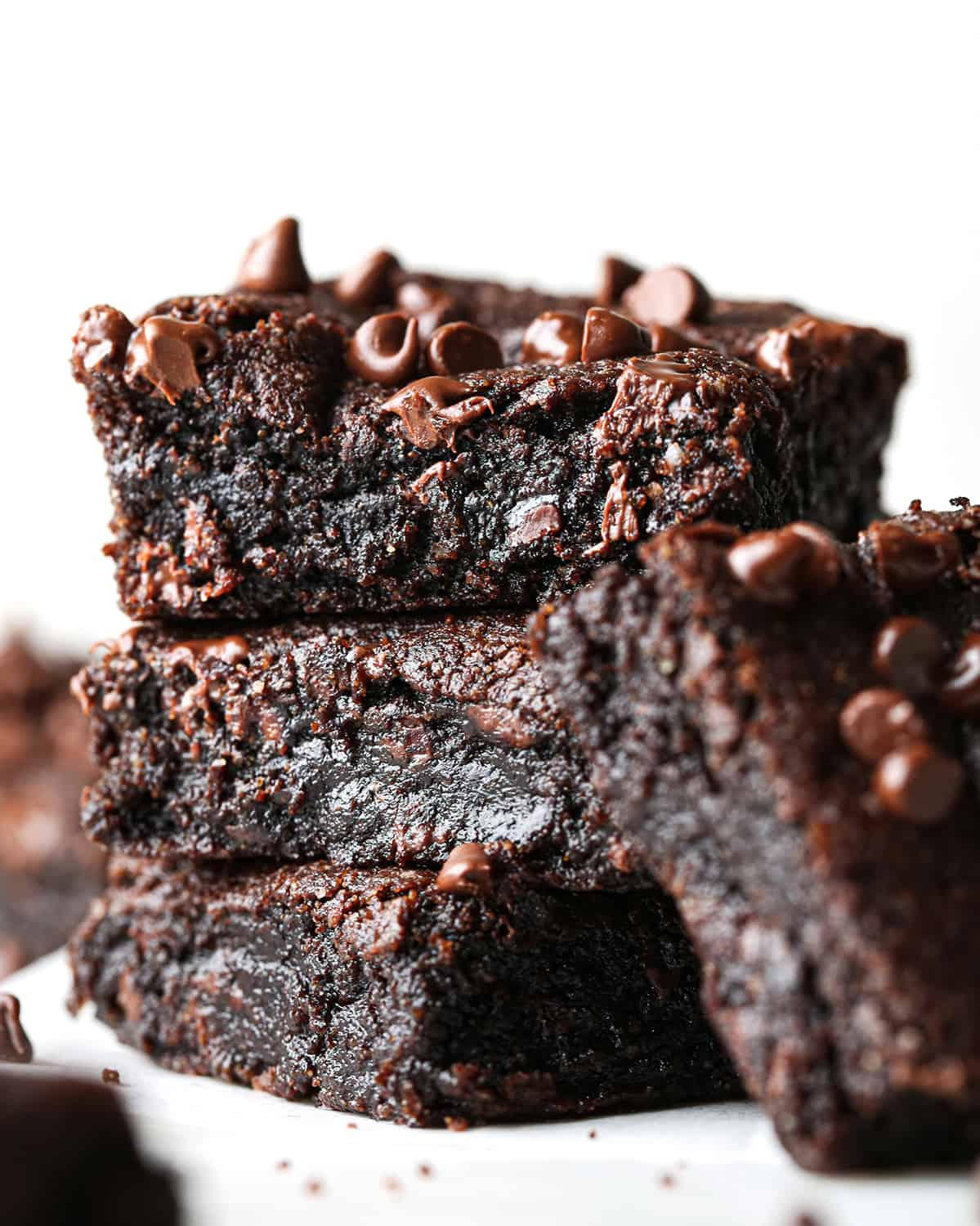 stack of 3 paleo brownies with another leaning against them