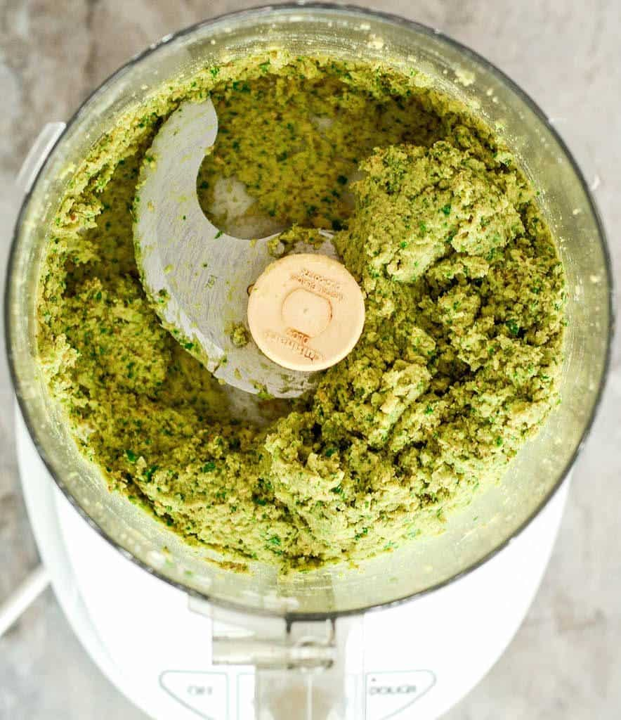 Overhead view of a food processor with the finished healthy vegan baked falafel mixture in it