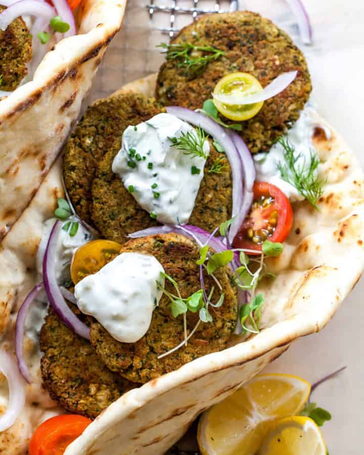 overhead photo of baked falafel in a pita with tzatziki