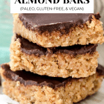 3 Almond bars stacked in a row with a chocolate layer on top of each one.