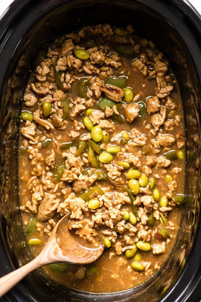 Overhead view of Thai Slow-Cooker Ground Turkey in the crockpot with a spoon stirring it