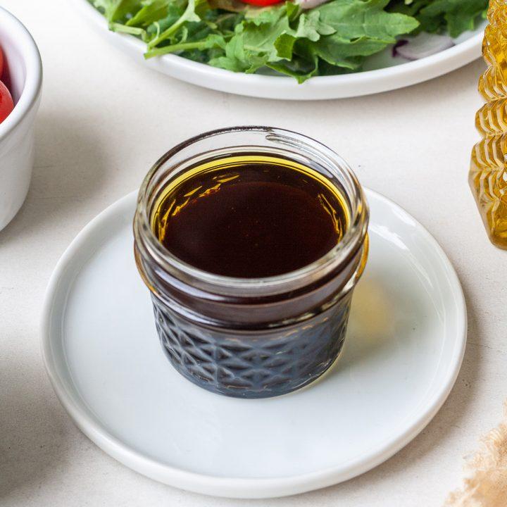 a glass jar of Maple Balsamic Vinaigrette Dressing