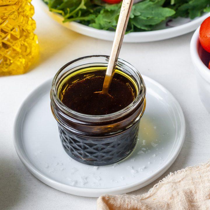 glass jar with Maple Balsamic Vinaigrette Dressing inside