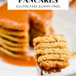 Stacked Zucchini Banana Pancakes with a bite missing and a fork.