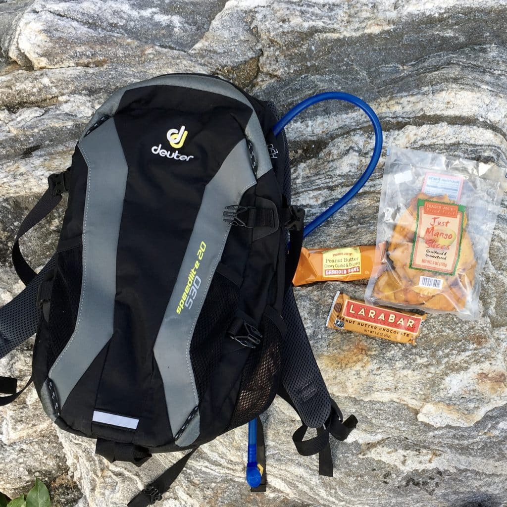 overhead view of a hydration pack and kids snacks in The Complete Guide to Hiking with Kids