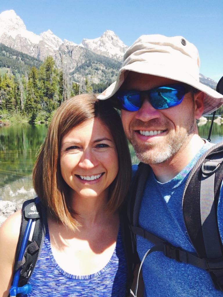 Photo of mom and dad in the mountains in The Complete Guide to Hiking with Kids!