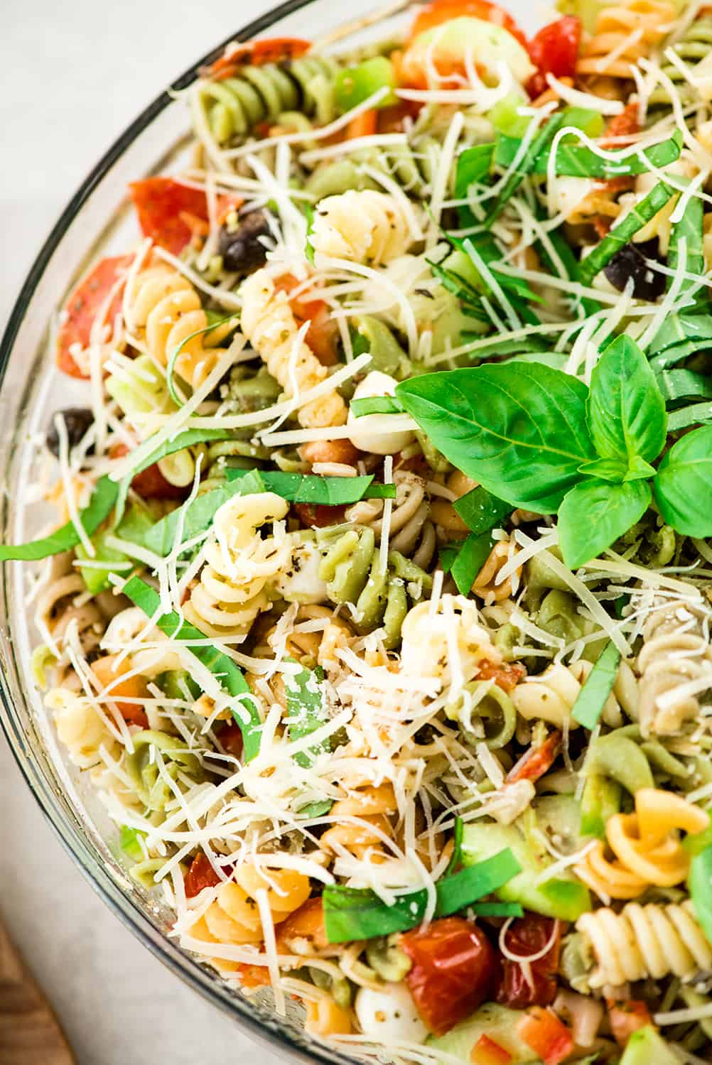 up close overhead view of Best Pasta Salad Recipe with Homemade Dressing in a large glass bowl