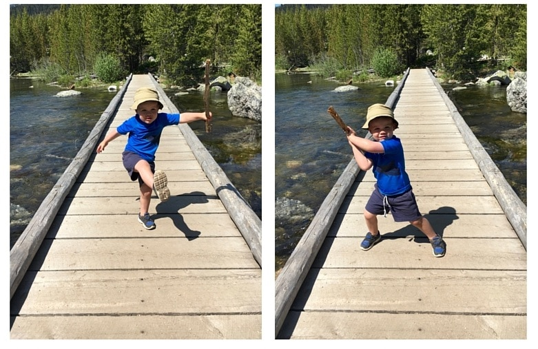 4 year old boy playing on a bridge in the mountains in The Complete Guide to Hiking with Kids