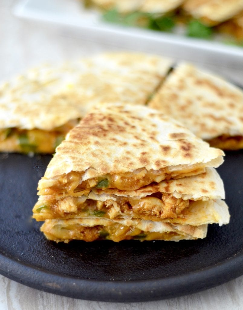 Front view of a stack of three triangular pieces of Best Chicken Quesadilla Recipe