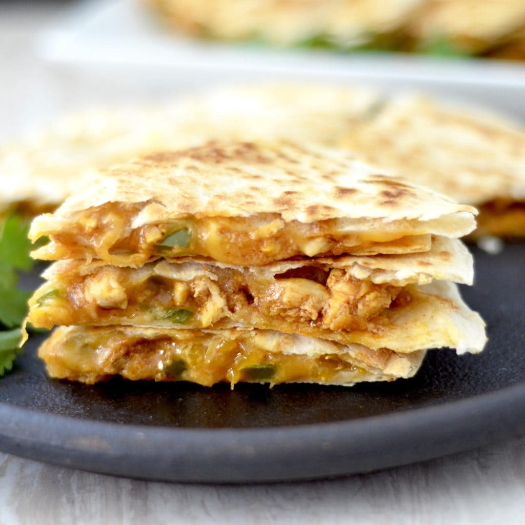 front view of a stack of three pieces of Best Chicken Quesadilla Recipe