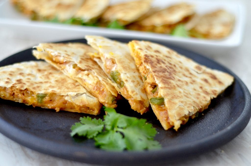 Front view of four pieces of Best Chicken Quesadilla Recipe on a plate