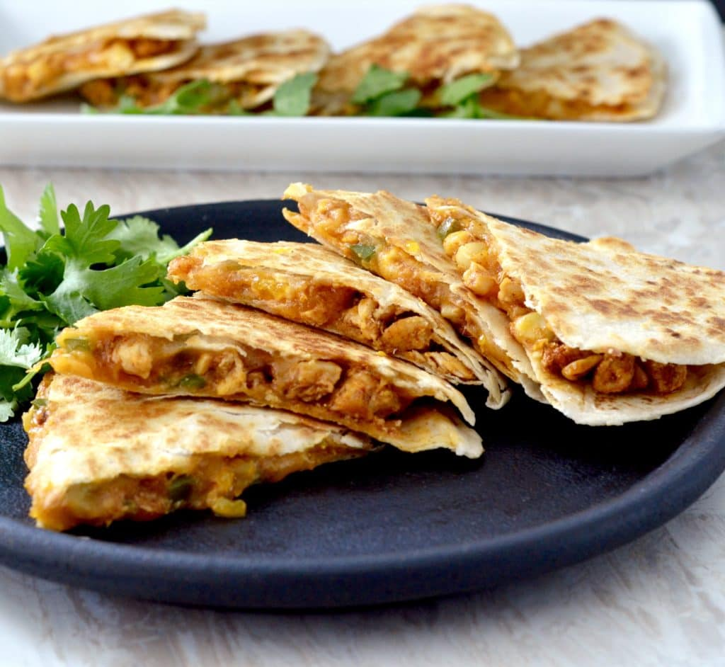 Front view of a plate with five pieces of Best Chicken Quesadilla Recipe