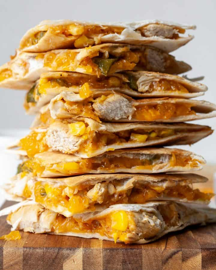 front view of a stack of 8 pieces of chicken quesadilla