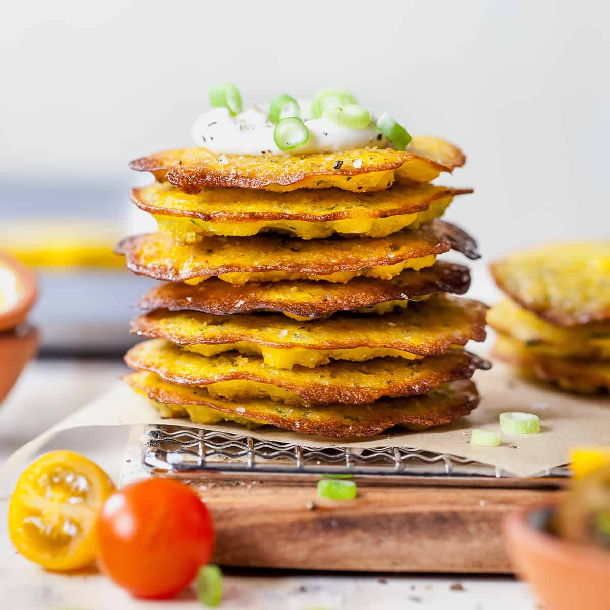 front view of a stack of 7 corn and zucchini fritters