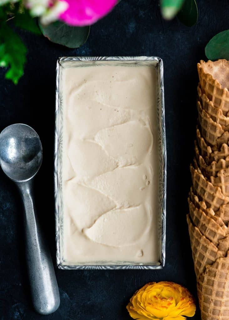 Overhead view of Paleo Vanilla Ice Cream in a rectangular loaf pan after being frozen.