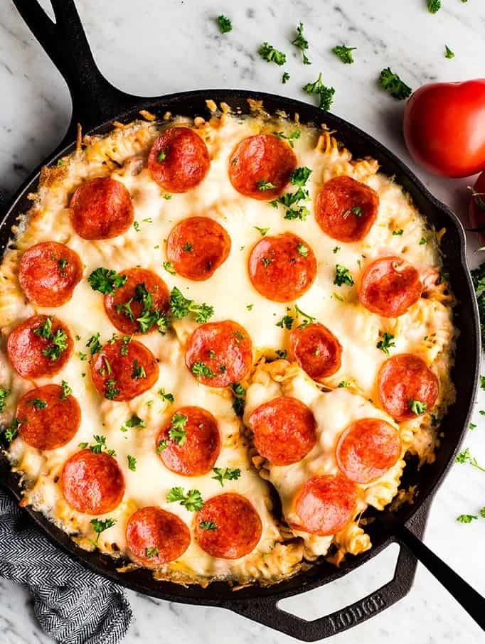 Overhead view of easy pizza casserole in a cast iron skillet