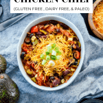 Overview image of chicken chili with toppings.