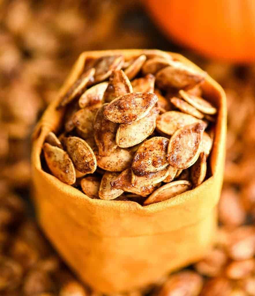 Up close front view of a bag full of Homemade Cinnamon Sugar Pumpkin Seeds