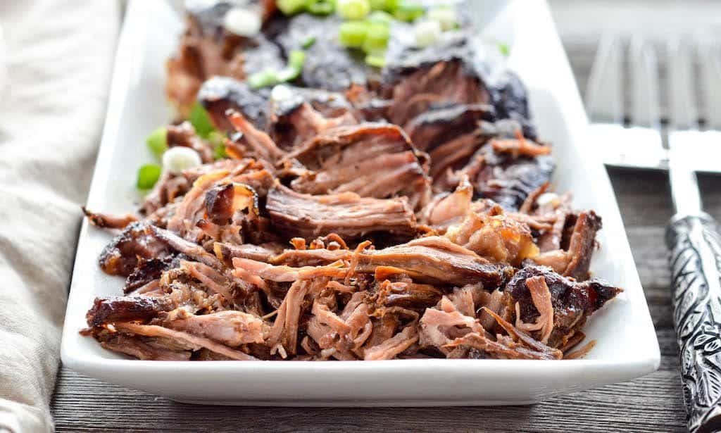 Front view of shredded Slow Cooker Balsamic Pot Roast on a serving dish