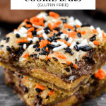 Sideview of 2 stacked candy cookie bars.