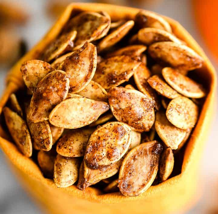 up close front view of Homemade Cinnamon Sugar Pumpkin Seeds in a small bag