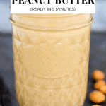 Sideview of peanut butter in a mason jar.