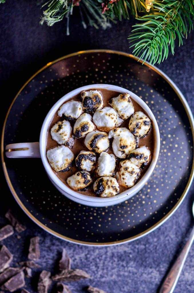 Overhead view of Dairy-Free Hot Chocolate in a mug with toasted marshmallows