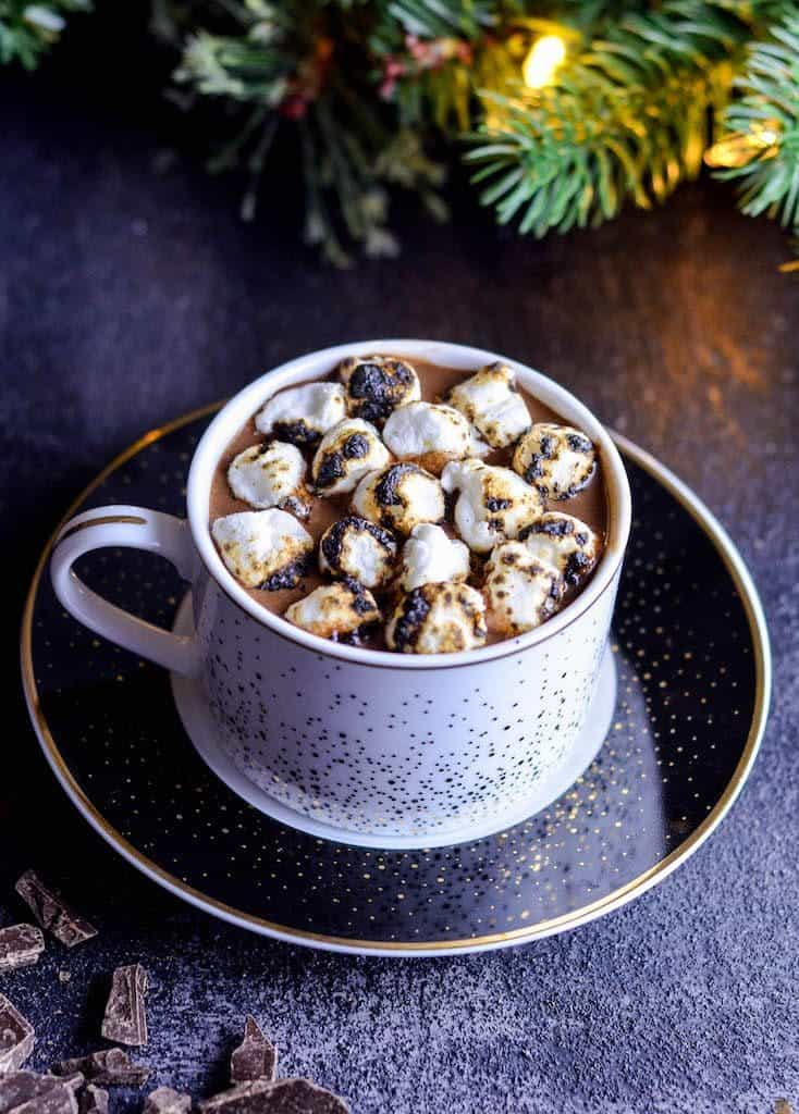 Overhead side view of a mug of Dairy-Free Hot Chocolate recipe with marshmallows