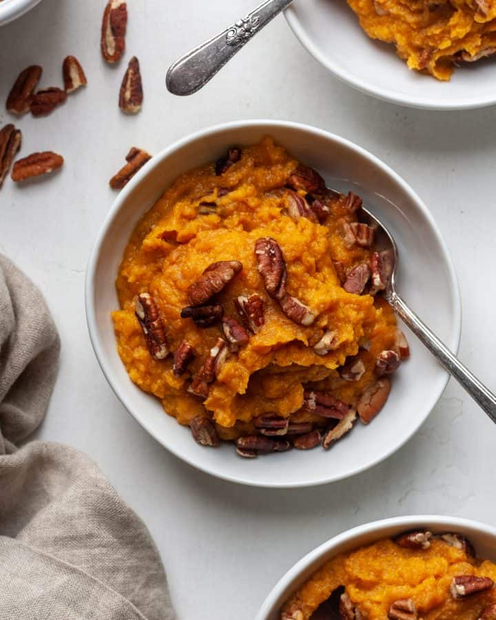 overhead view of Healthy Sweet Potato Casserole in a bowl with a spoon