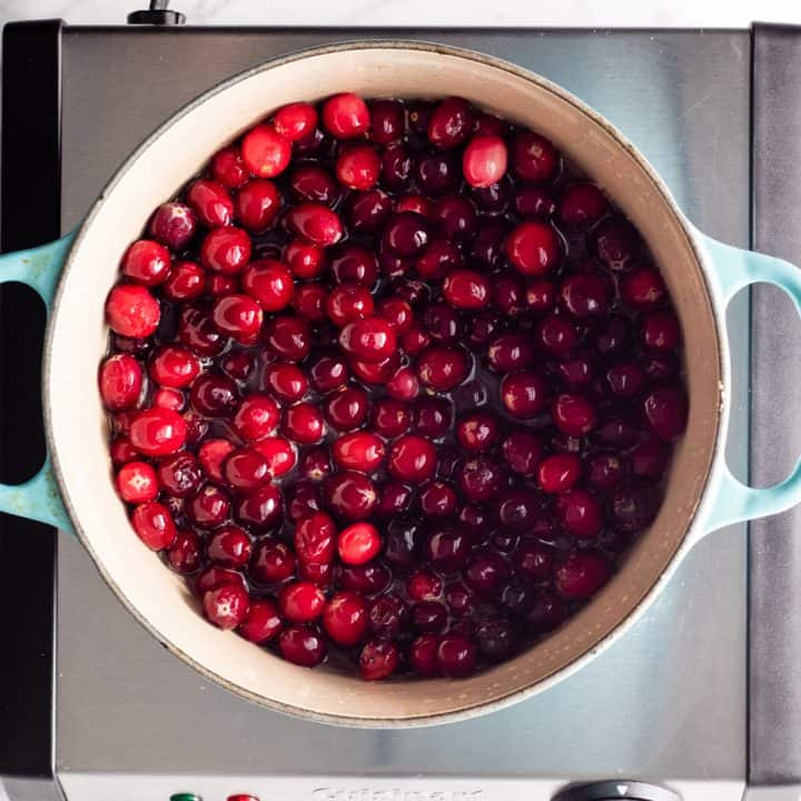 overhead photo showing how to make homemade cranberry sauce with orange juice