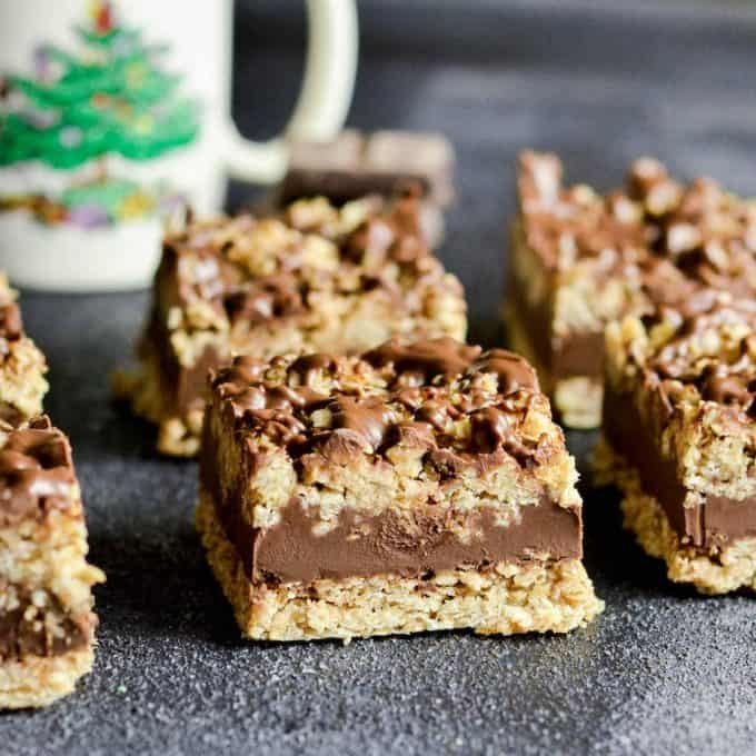 Front view of six No-Bake Chocolate Peanut Butter Oatmeal Bars arranged in two rows of three