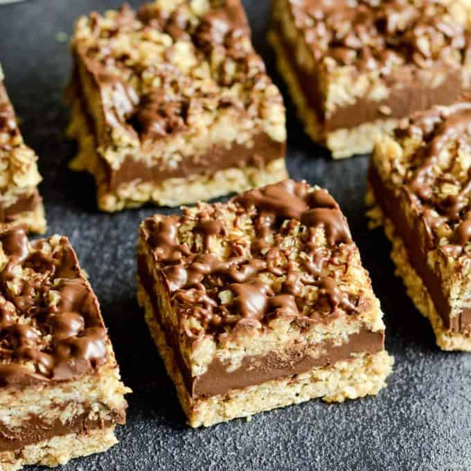 Overhead view of six No-Bake Chocolate Peanut Butter Oatmeal Bars arranged in two rows of three