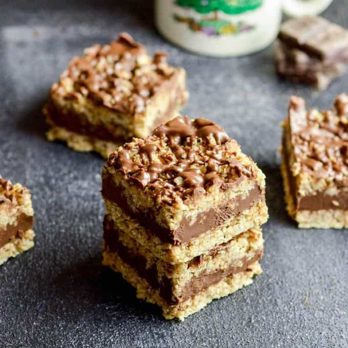 overhead view of five No-Bake Chocolate Peanut Butter Oatmeal Bars two stacked on each other