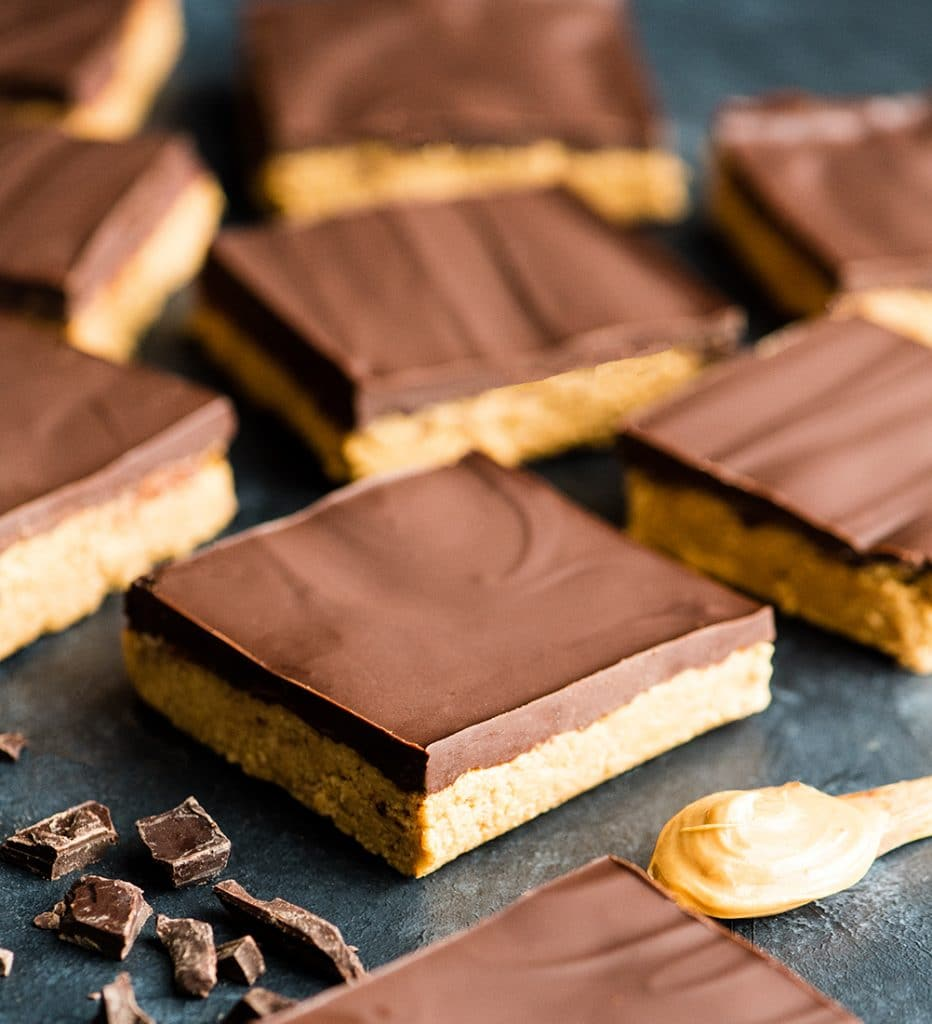 Front view of nine No-Bake Chocolate Peanut Butter Bars arranged on a surface