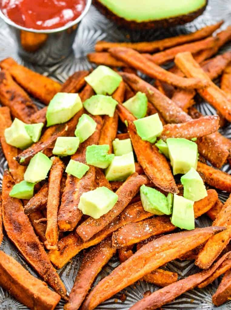 overhead view of Peanut Butter Crusted Sweet Potato Fries with avocado on top