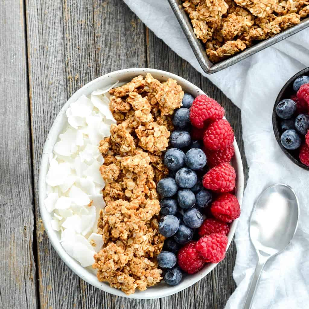 Healthy peanut butter granola joyfoodsunshine overhead view of a bowl of vegan healthy peanut butter granola with fresh berries and flaked ccuart Choice Image