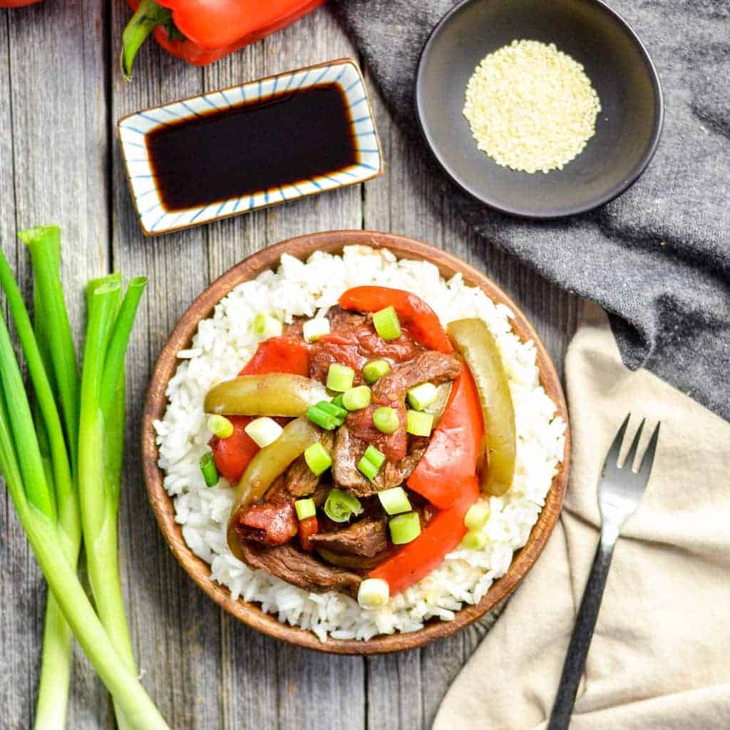 overhead view of Slow Cooker Pepper Steak on a plate with rice