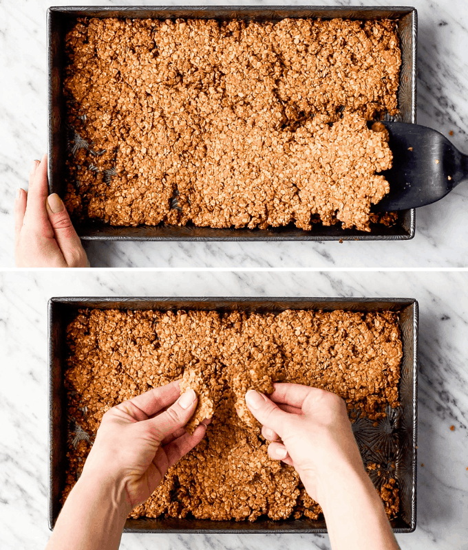 Two overhead photos, the top one showing the granola being lifted out of a baking pan with a spatula, the bottom photo shows hands breaking the piece of granola into clumps.