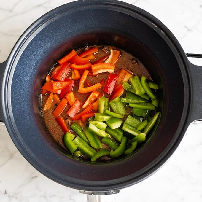 overhead photo showing how to make slow cooker pepper steak