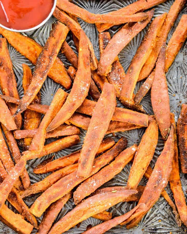 Overhead view of a baking sheet with Peanut Butter Sweet Potato Fries