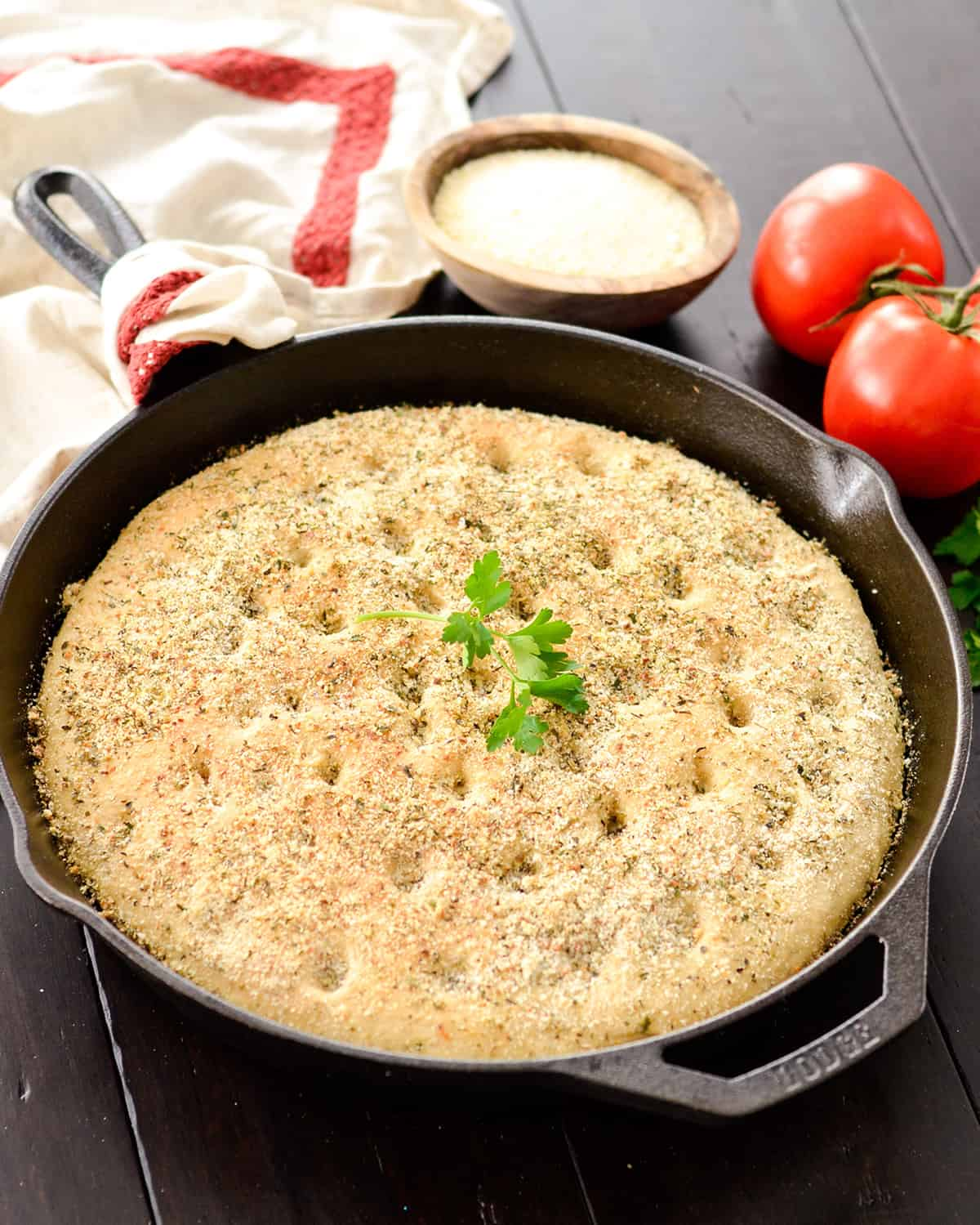 skillet with baked Whole Wheat Focaccia Bread with parsley on top