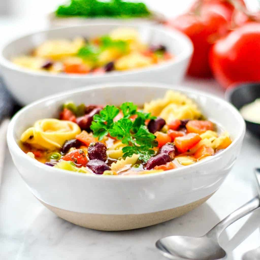 Front view of a bowl of Easy Tortellini Soup Recipe